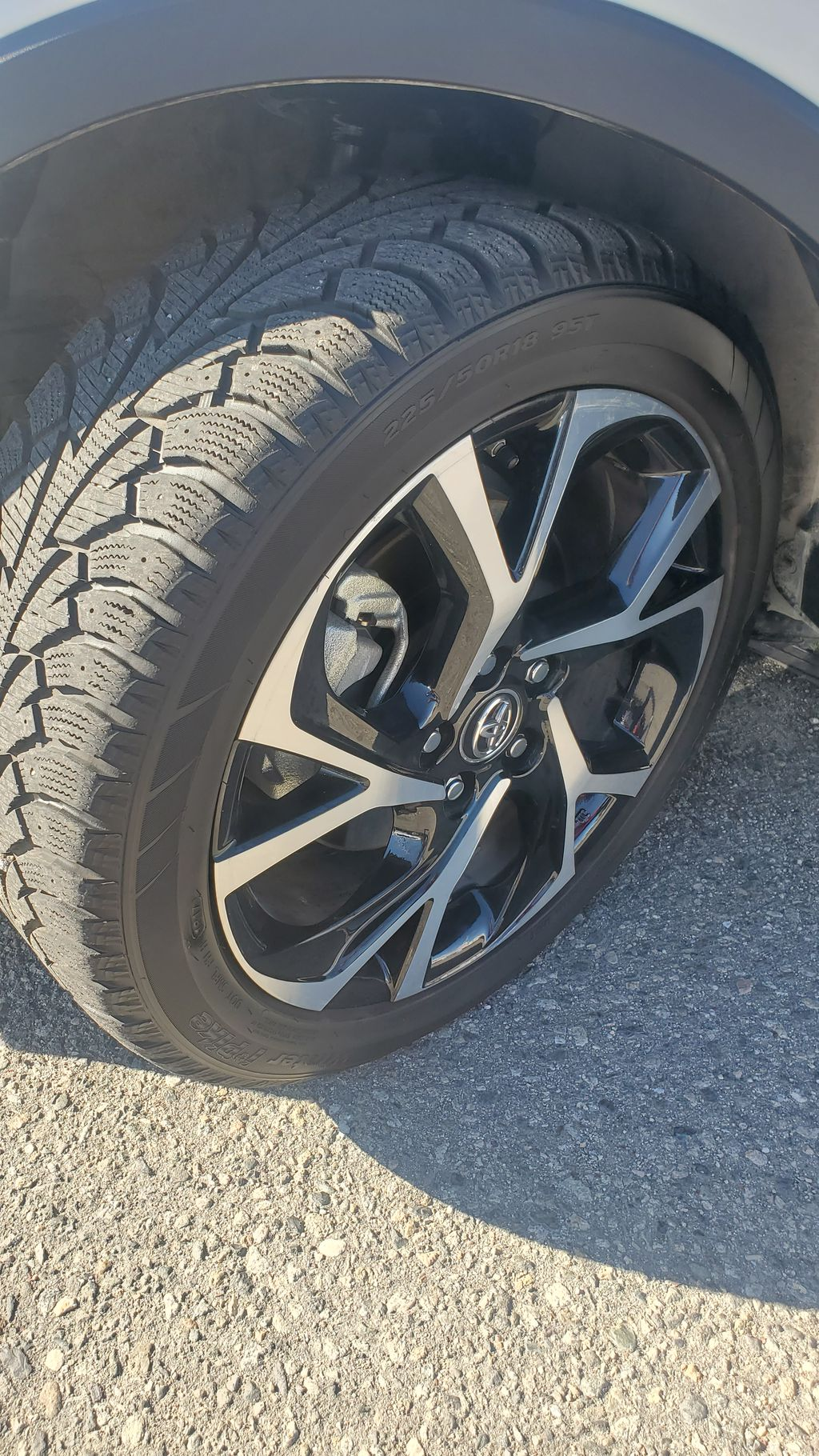 White[Blizzard Pearl with Black Roof] 2019 Toyota C-HR Left Front Rim and Tire Photo in Kelowna BC