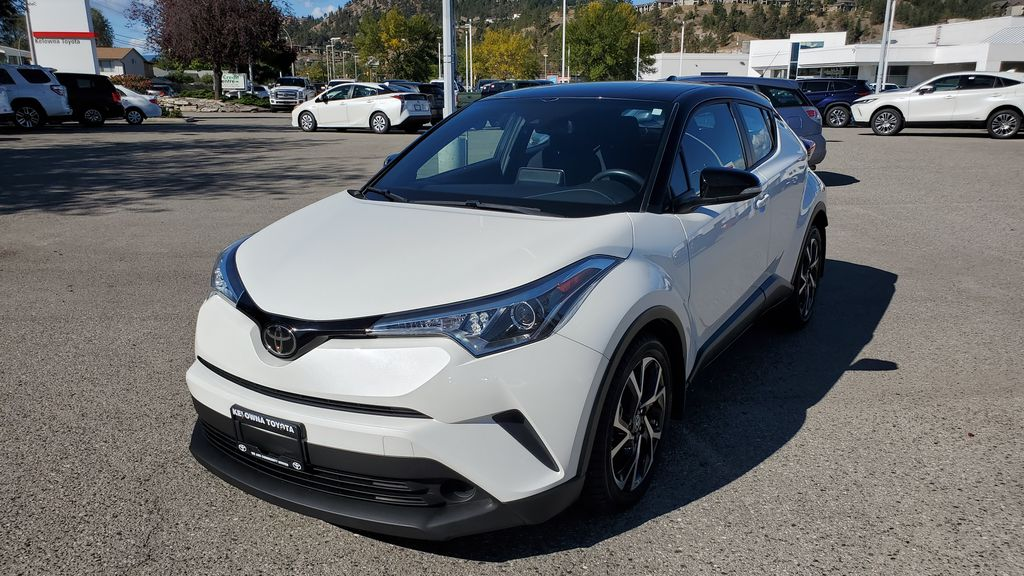 White[Blizzard Pearl with Black Roof] 2019 Toyota C-HR Left Front Corner Photo in Kelowna BC