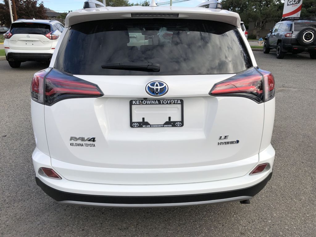 White[Alpine White] 2017 Toyota RAV4 Hybrid Rear of Vehicle Photo in Kelowna BC