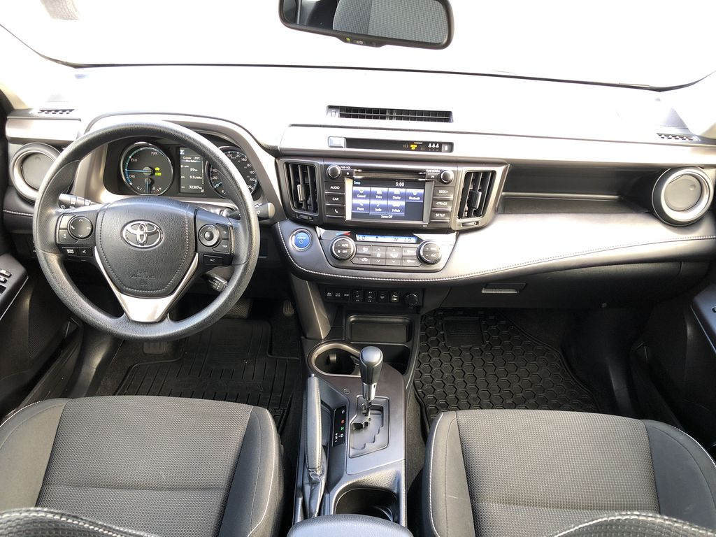 White[Alpine White] 2017 Toyota RAV4 Hybrid Main Interior Photo in Kelowna BC