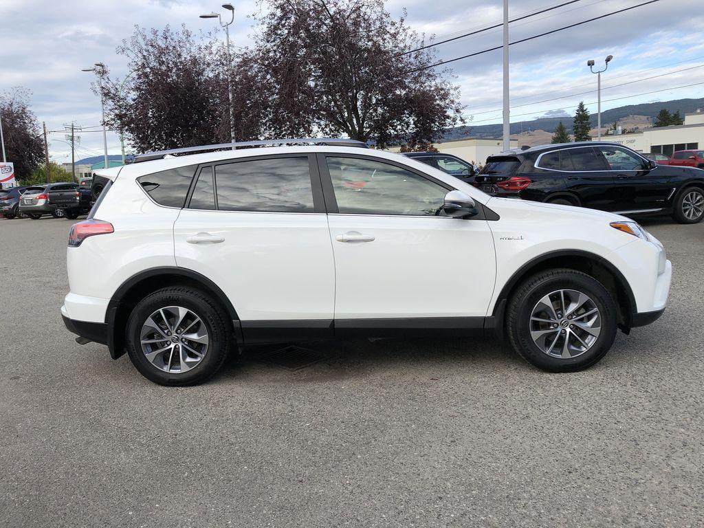 White[Alpine White] 2017 Toyota RAV4 Hybrid Right Side Photo in Kelowna BC