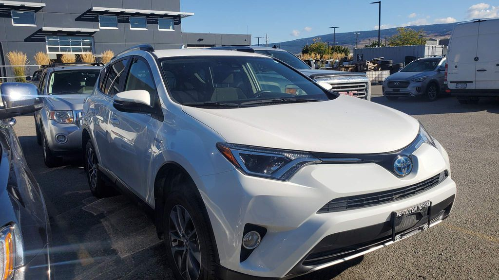 White[Alpine White] 2017 Toyota RAV4 Hybrid Right Front Corner Photo in Kelowna BC