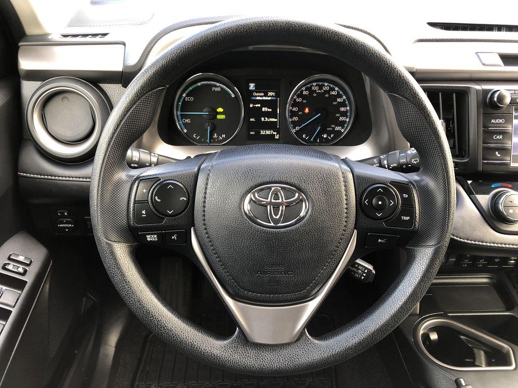 White[Alpine White] 2017 Toyota RAV4 Hybrid Steering Wheel and Dash Photo in Kelowna BC
