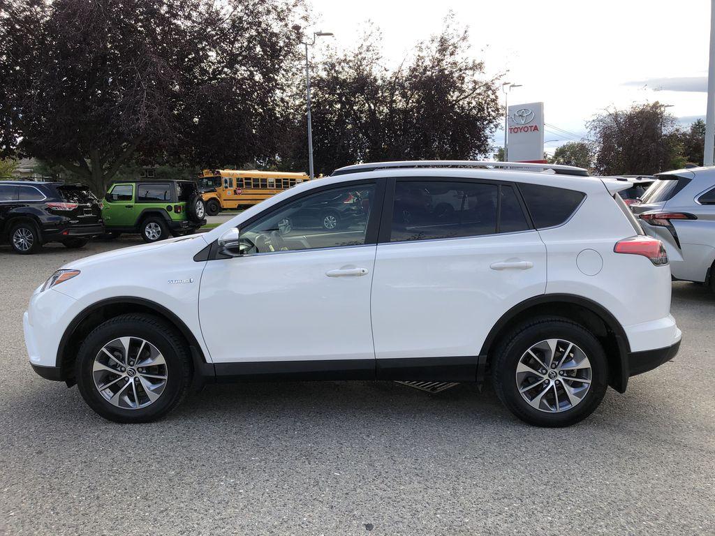 White[Alpine White] 2017 Toyota RAV4 Hybrid Left Side Photo in Kelowna BC