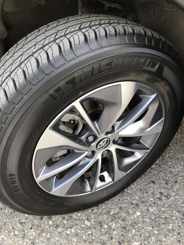 White[Alpine White] 2017 Toyota RAV4 Hybrid Left Front Rim and Tire Photo in Kelowna BC