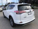White[Alpine White] 2017 Toyota RAV4 Hybrid Left Rear Corner Photo in Kelowna BC