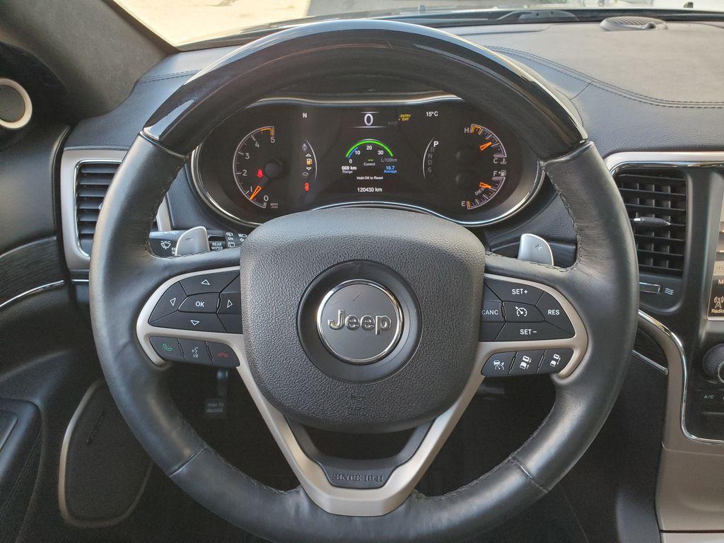 Black[Brilliant Black Crystal Pearl] 2015 Jeep Grand Cherokee Summit Diesel Steering Wheel and Dash Photo in Kelowna BC