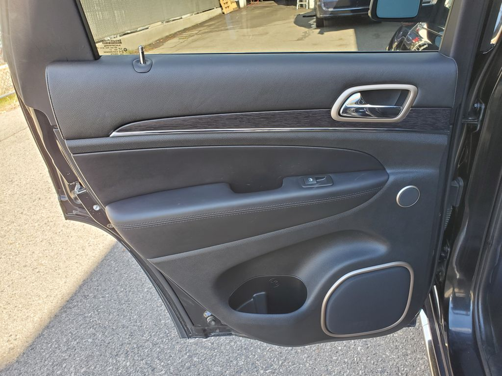 Black[Brilliant Black Crystal Pearl] 2015 Jeep Grand Cherokee Summit Diesel Left Rear Interior Door Panel Photo in Kelowna BC