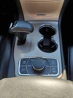 Black[Brilliant Black Crystal Pearl] 2015 Jeep Grand Cherokee Summit Diesel Center Console Photo in Kelowna BC