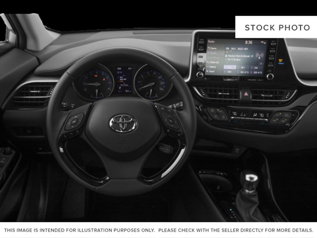 White[Blizzard Pearl] 2021 Toyota C-HR Steering Wheel and Dash Photo in Kelowna BC