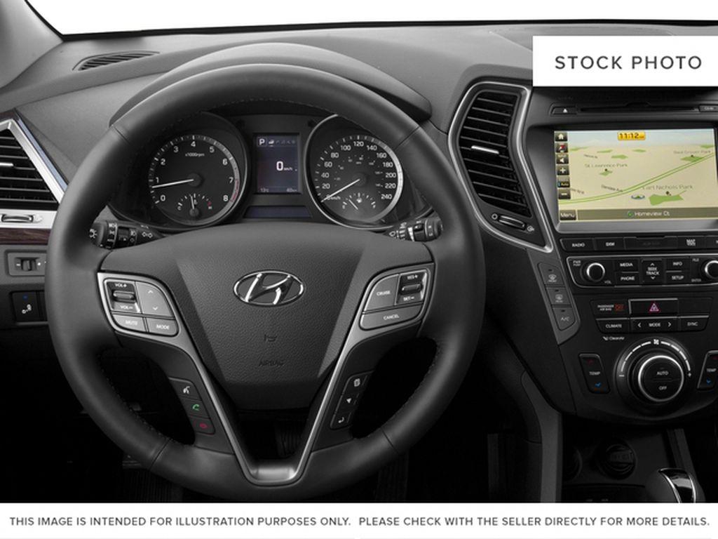 White[Monaco White] 2017 Hyundai Santa Fe XL Steering Wheel and Dash Photo in Kelowna BC