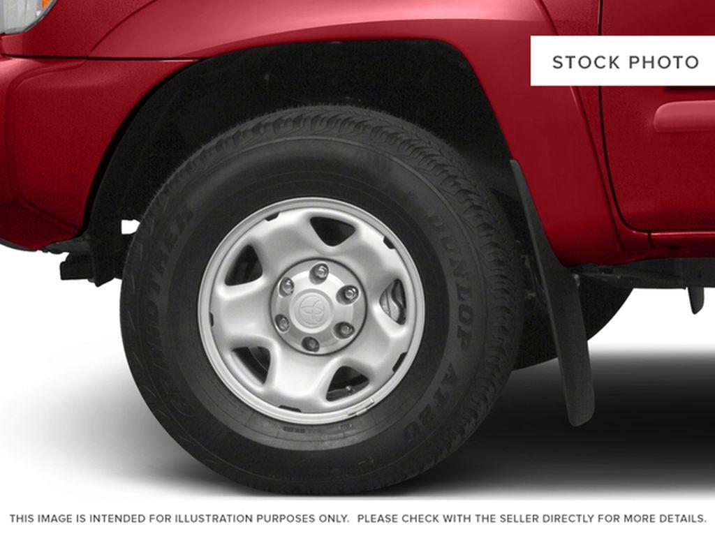 White[Alpine White] 2015 Toyota Tacoma Left Front Rim and Tire Photo in Kelowna BC