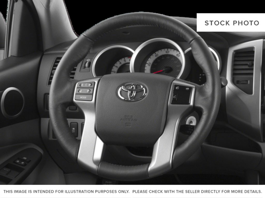 White[Alpine White] 2015 Toyota Tacoma Steering Wheel and Dash Photo in Kelowna BC