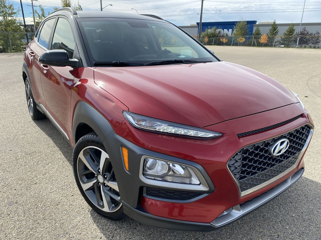 Red[Pulse Red w/Black Roof] 2018 Hyundai Kona Right Front Corner Photo in Edmonton AB