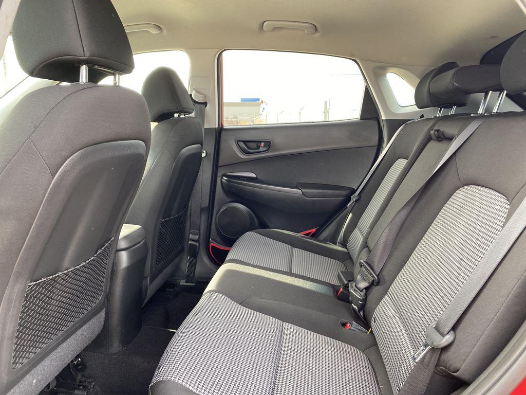 Red[Pulse Red w/Black Roof] 2018 Hyundai Kona Left Side Rear Seat  Photo in Edmonton AB