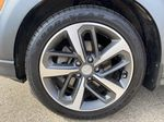 Red[Pulse Red w/Black Roof] 2018 Hyundai Kona Left Front Rim and Tire Photo in Edmonton AB