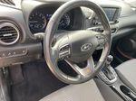 Red[Pulse Red w/Black Roof] 2018 Hyundai Kona Steering Wheel and Dash Photo in Edmonton AB