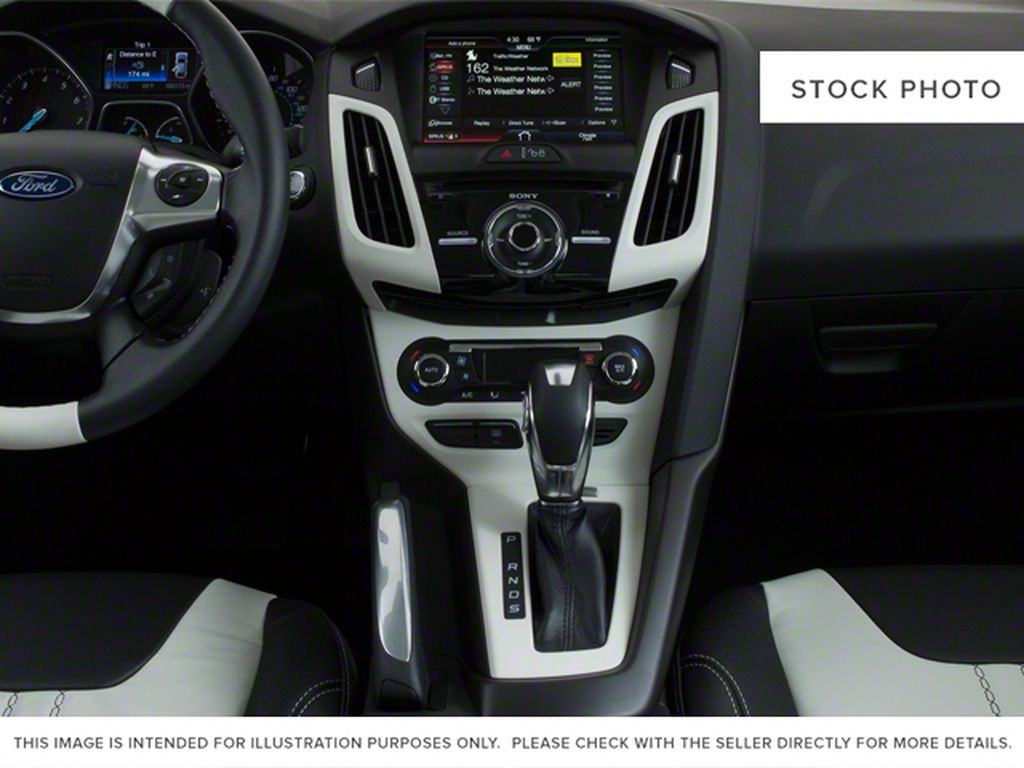 Blue[Blue Candy Metallic Tinted] 2013 Ford Focus Center Console Photo in Brandon MB