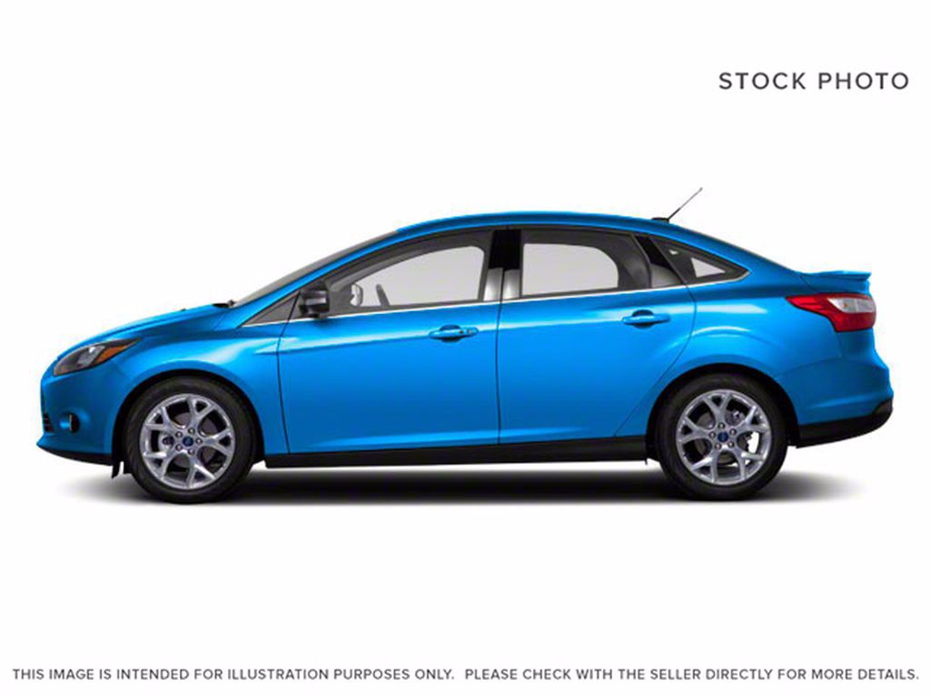Blue[Blue Candy Metallic Tinted] 2013 Ford Focus Left Front Interior Photo in Brandon MB