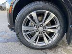 Black[Manhattan Noir Metallic] 2020 Cadillac XT6 Premium Luxury Left Front Rim and Tire Photo in Calgary AB