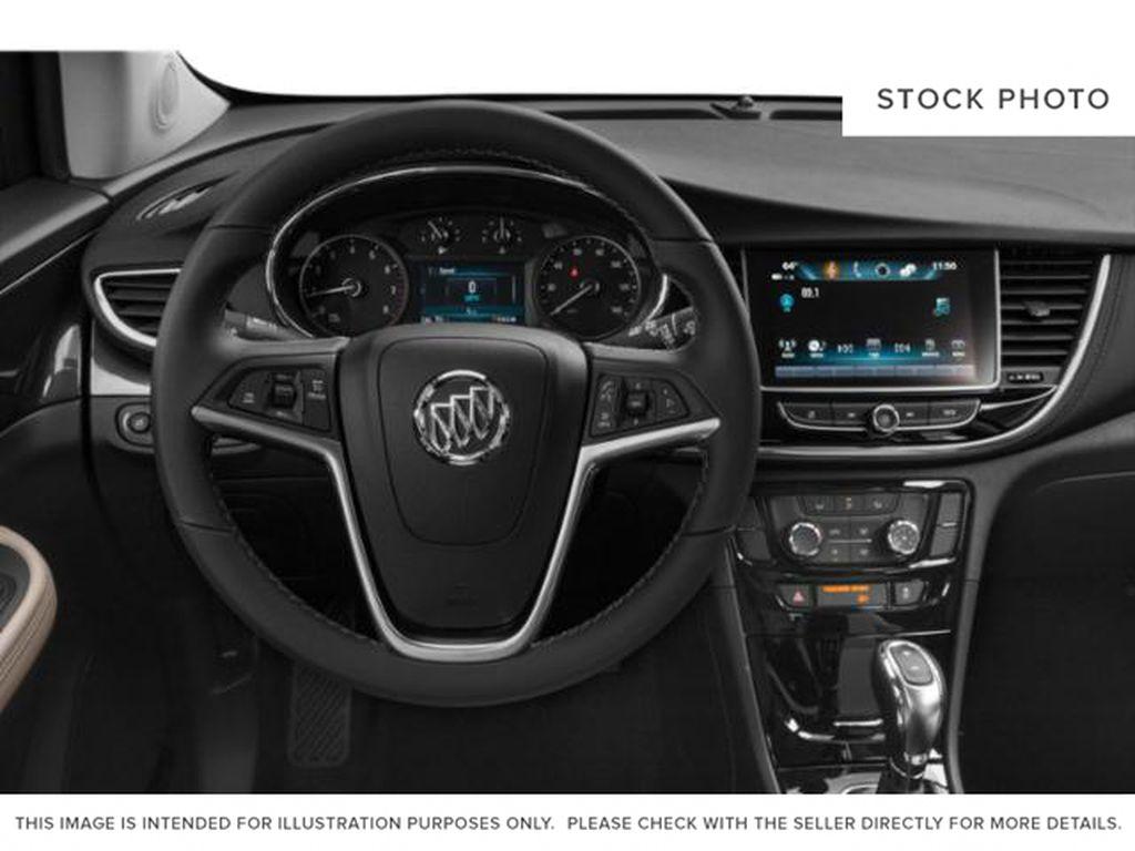 White[Summit White] 2022 Buick Encore Steering Wheel and Dash Photo in Lethbridge AB