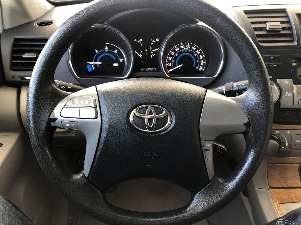 Silver[Classic Silver Metallic] 2009 Toyota Highlander Hybrid Steering Wheel and Dash Photo in Kelowna BC