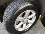 Silver[Classic Silver Metallic] 2009 Toyota Highlander Hybrid Left Front Rim and Tire Photo in Kelowna BC