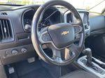 White[Summit White] 2017 Chevrolet Colorado Steering Wheel and Dash Photo in Edmonton AB