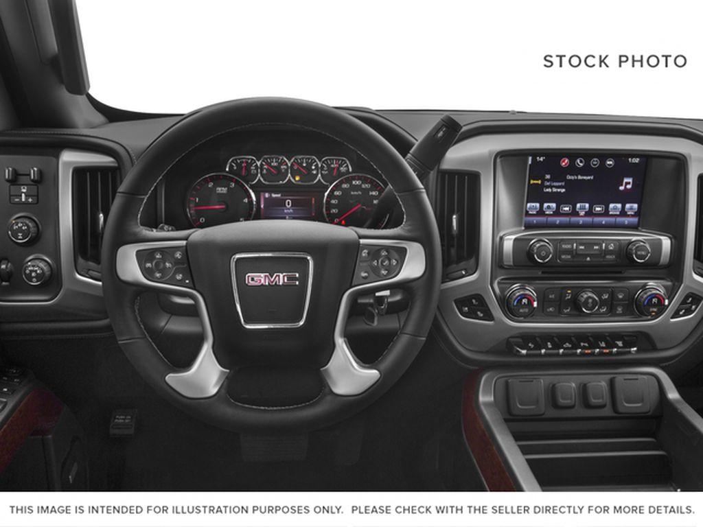 Silver[Quicksilver Metallic] 2018 GMC Sierra 2500HD Steering Wheel and Dash Photo in Fort Macleod AB