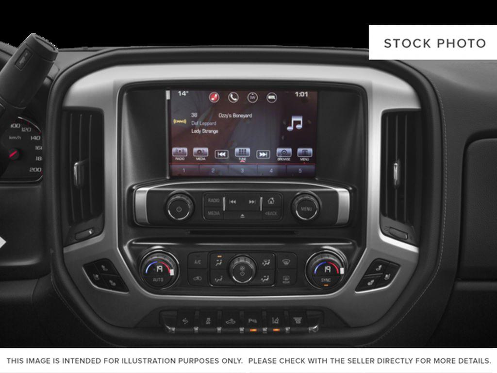 Silver[Quicksilver Metallic] 2018 GMC Sierra 2500HD Radio Controls Closeup Photo in Fort Macleod AB