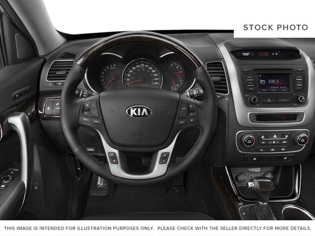 Silver[Satin Metal Metallic] 2015 Kia Sorento Steering Wheel and Dash Photo in Lethbridge AB