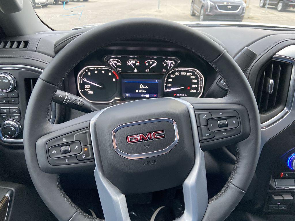 Silver[Quicksilver Metallic] 2021 GMC Sierra 1500 Elevation Steering Wheel and Dash Photo in Calgary AB