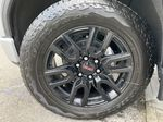 Silver[Quicksilver Metallic] 2021 GMC Sierra 1500 Elevation Left Front Rim and Tire Photo in Calgary AB