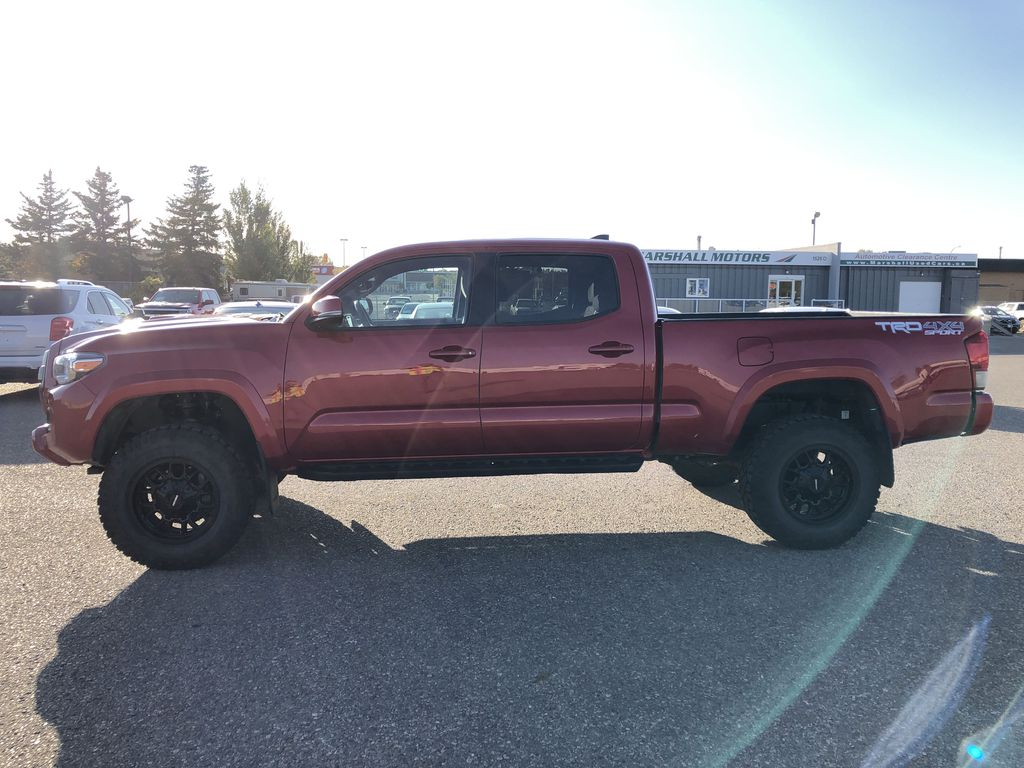 Red 2017 Toyota Tacoma TRD SPORT *Heated Seats* *Lifted* Left Side Photo in Brandon MB