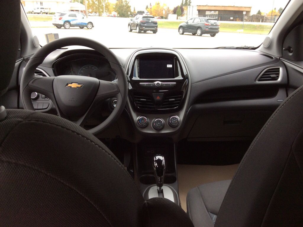 Blue 2022 Chevrolet Spark Strng Wheel/Dash Photo: Frm Rear in Westlock AB