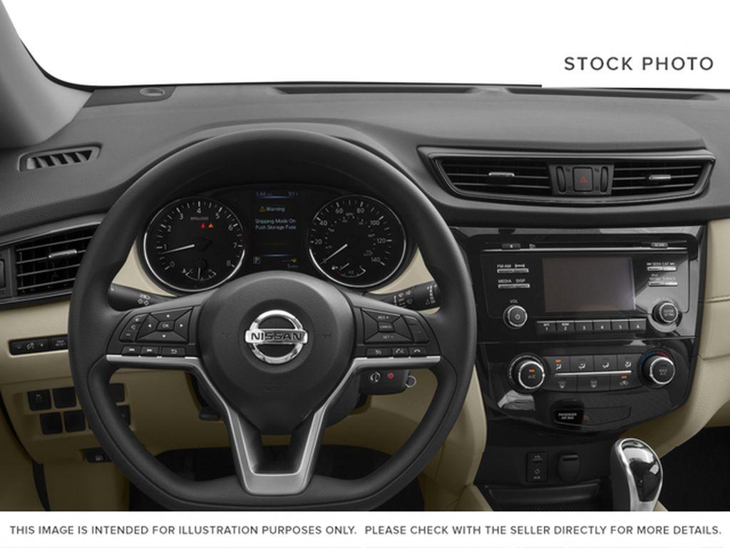 White[Glacier White] 2017 Nissan Rogue Steering Wheel and Dash Photo in Okotoks AB