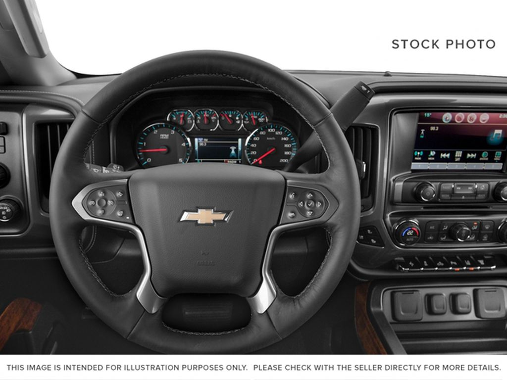 White[Iridescent Pearl Tricoat] 2018 Chevrolet Silverado 3500HD Steering Wheel and Dash Photo in Fort Macleod AB