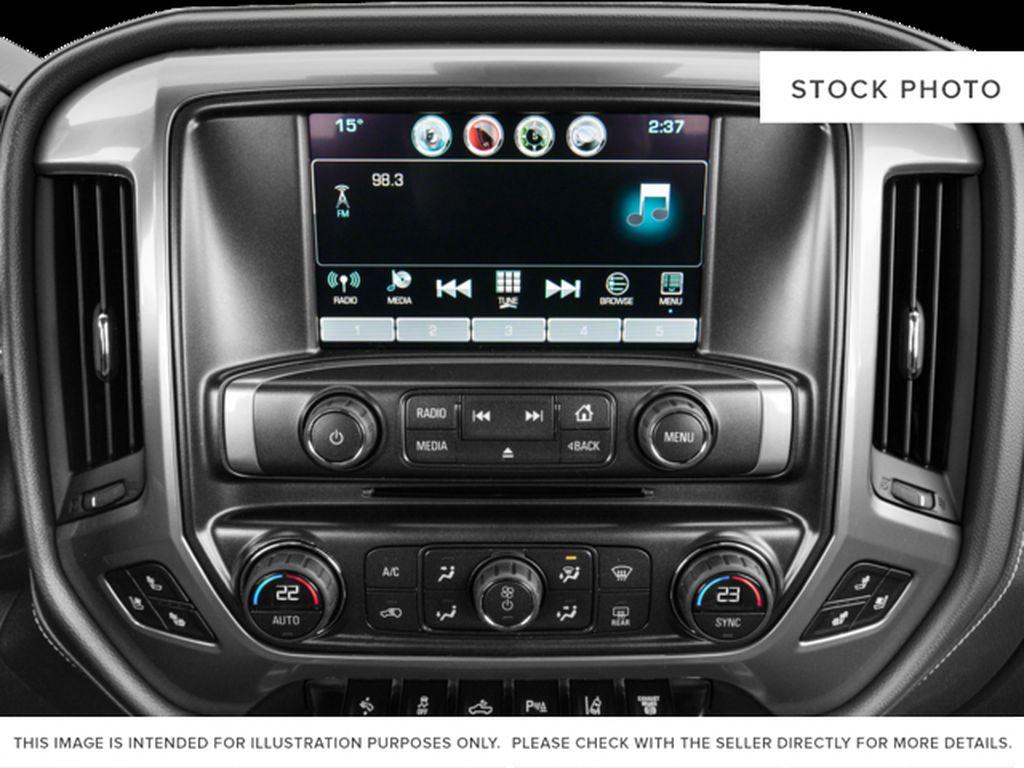 White[Iridescent Pearl Tricoat] 2018 Chevrolet Silverado 3500HD Radio Controls Closeup Photo in Fort Macleod AB