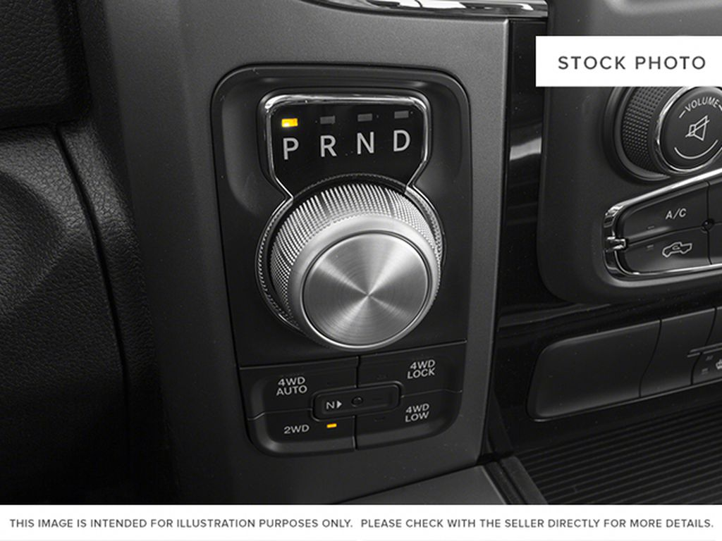 Red[Deep Cherry Red Crystal Pearlcoat] 2014 Ram 1500 Center Console Photo in Fort Macleod AB