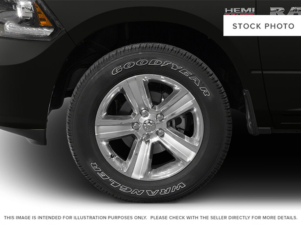 Red[Deep Cherry Red Crystal Pearlcoat] 2014 Ram 1500 Left Front Rim and Tire Photo in Fort Macleod AB