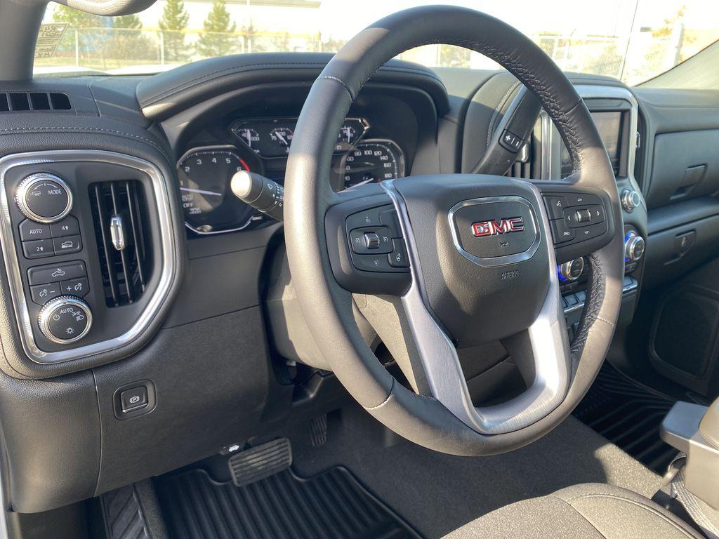 White[Summit White] 2021 GMC Sierra 1500 Steering Wheel and Dash Photo in Edmonton AB