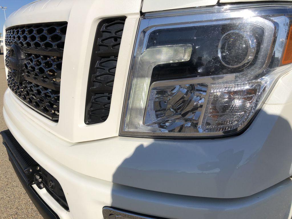 White[Glacier White] 2018 Nissan Titan XD Left Front Head Light / Bumper and Grill in Edmonton AB