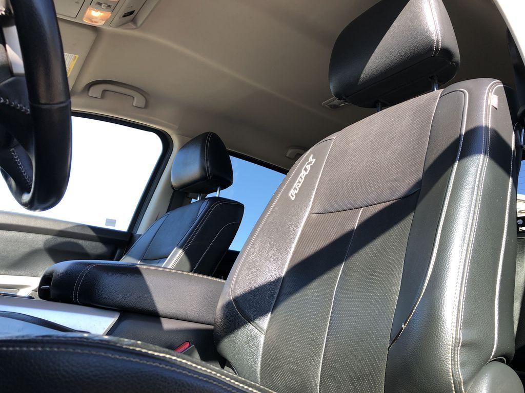 White[Glacier White] 2018 Nissan Titan XD Left Front Interior Photo in Edmonton AB