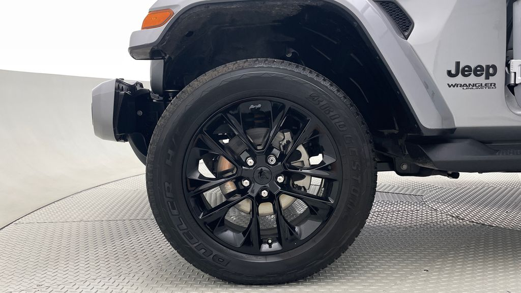 Silver[Billet Silver Metallic] 2021 Jeep Wrangler Unlimited High Altitude - RARE Gas/Electric Hybrid Left Front Rim and Tire Photo in Winnipeg MB