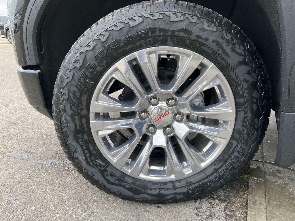 Black[Onyx Black] 2021 GMC Sierra 1500 Denali Left Front Rim and Tire Photo in Calgary AB