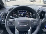 Black[Onyx Black] 2021 GMC Sierra 1500 Denali Steering Wheel and Dash Photo in Calgary AB
