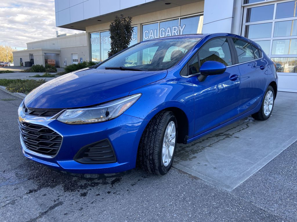 Blue[Kinetic Blue Metallic] 2019 Chevrolet Cruze LT Left Front Head Light / Bumper and Grill in Calgary AB