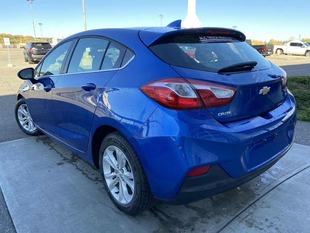 Blue[Kinetic Blue Metallic] 2019 Chevrolet Cruze LT Left Rear Corner Photo in Calgary AB