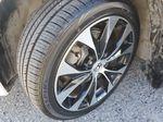 White[Taffeta White] 2013 Honda Civic SI Sedan Left Front Rim and Tire Photo in Kelowna BC