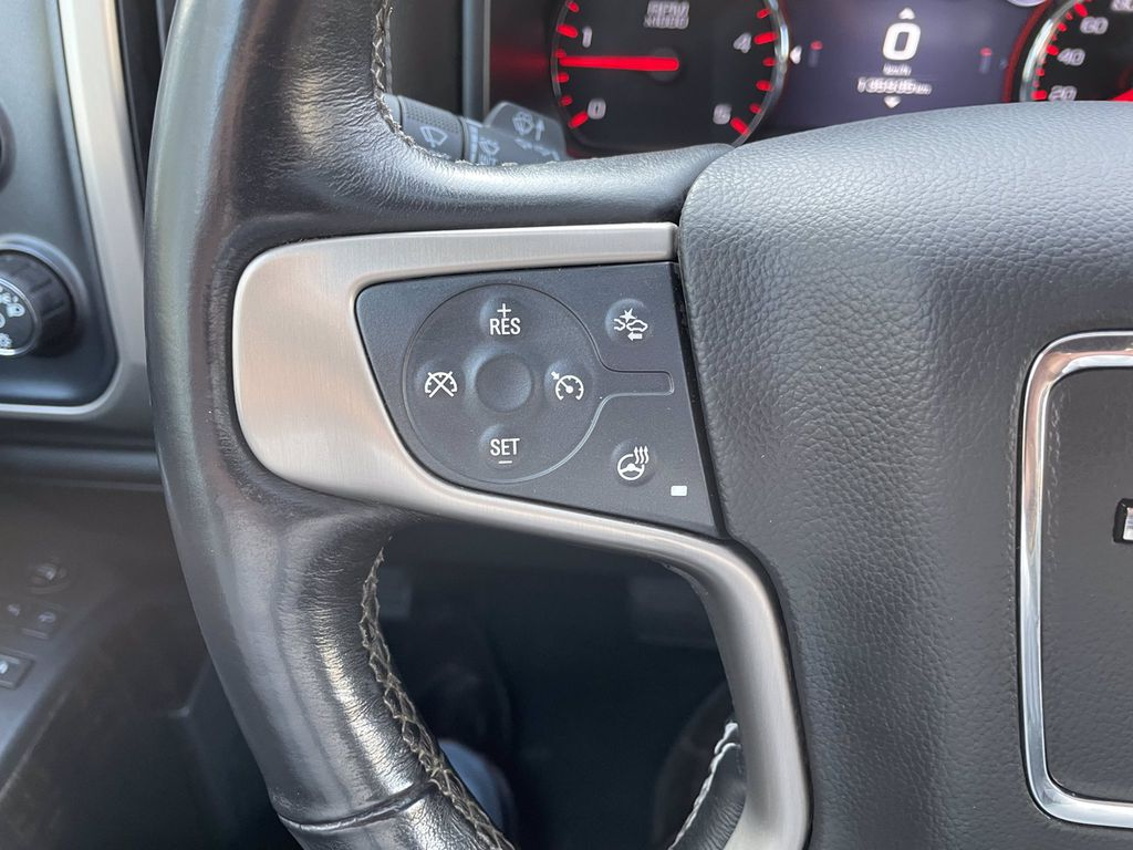 Black[Onyx Black] 2016 GMC Sierra 2500HD Radio Controls Closeup Photo in Brandon MB
